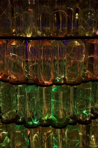 a stacked cylinder of lit bottles