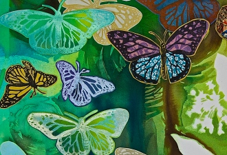 close-up of block print butterflies, chine colle, and watercolor