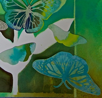 close-up of block print butterflies and watercolor